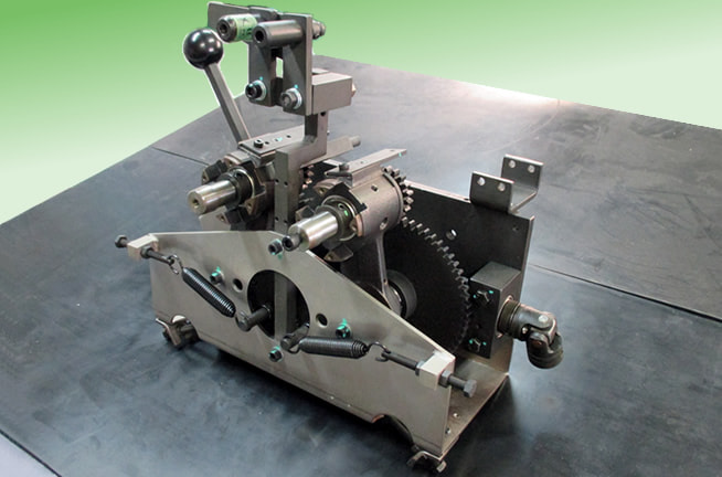 包装機部品(縦シーラー) 加工から組み立てまでの一貫自社製作
